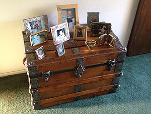 Antique trunk displays family photos