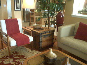 Antique trunk used as a living room end table