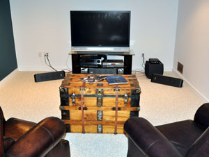 Antique trunk makes a nice game room center piece and storage unit
