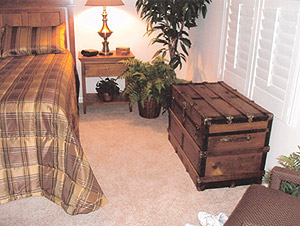 Antique trunk makes a beautiful addition to this bedroom